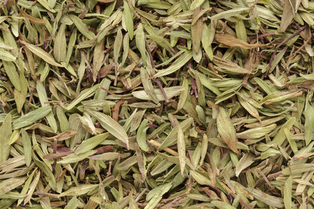 thymus: Organic dry (Thymus vulgaris) leaves. Macro close up background texture. Top view. Stock Photo