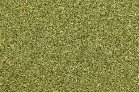 kelor: Organic dry Moringa or Sahjan (Moringa oleifera) leaves in tea cut size. Macro close up background texture. Top view.