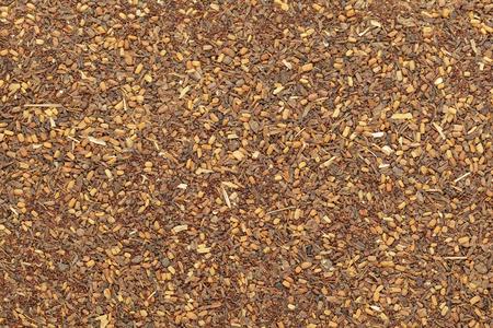 myrtaceae: Organic Red Mahogany or Eucalyptus (eucalyptus pellita) seeds. Macro closeup background texture. Top View. Stock Photo