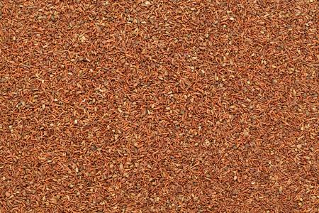 caoba: Caoba orgánico o eucalipto rojo (Eucalyptus globulus) semillas. textura de fondo Primer macro. Vista superior. Foto de archivo