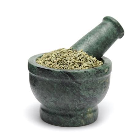 foeniculum vulgare: Organic Aniseed (Pimpinella anisum) on marble pestle. Isolated on white background.