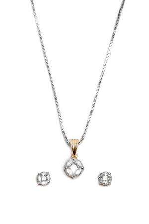 diamond necklace: Close up of a complete set of Gold and Diamond necklace with beautiful diamond earrings.