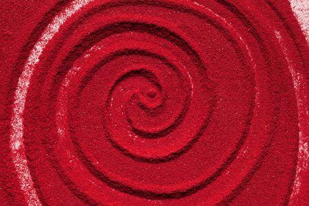 Close up spiral background texture of solid red color made of soil. Reklamní fotografie