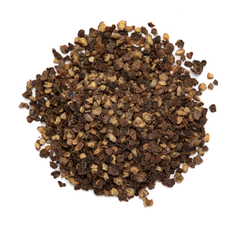 Dried Organic and cracked Black peppercorns.