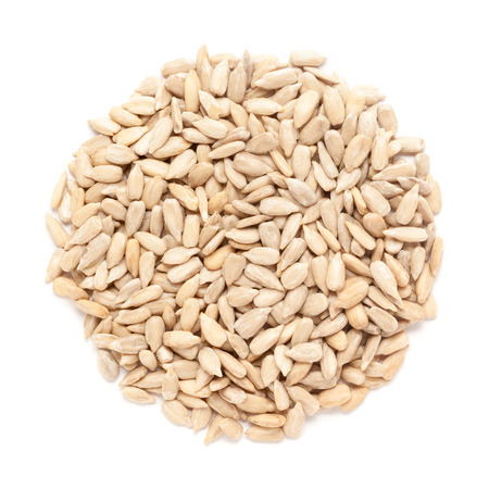Organic Sunflower seeds (Helianthus annuus) on white background