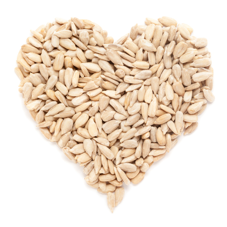 Organic Sunflower seeds (Helianthus annuus)  in heart shaped