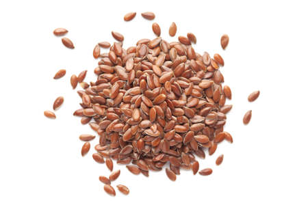 Macro Close up of Organic Brown flaxseeds (Linum usitatissimum) or linseed cleaned on a white background. Top view Stockfoto