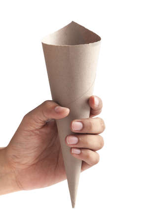 Close-up of empty brown Paper cone bag holding in hand, for snack packaging, craft paper for wrapping fries and nuggets in street food