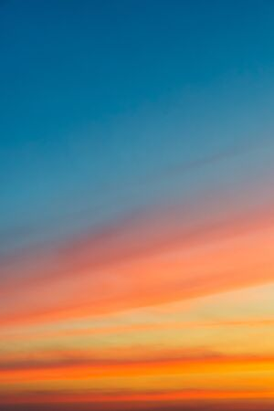 Colorful color of sky (Cloudy sky and orange light of the sun through the clouds with copy space) - vertical view