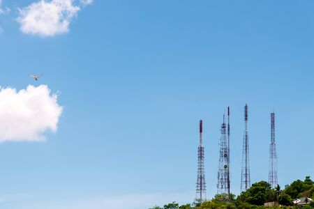 Telecommunication tower antenna and satellite dish on mountain