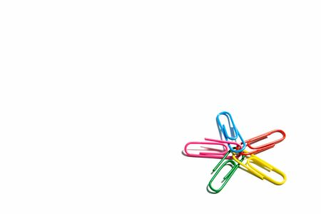 Colorful paper clips isolated on white background. Star shape.