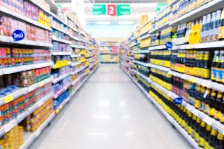 Supermarket aisle with product on shelves. Picture in defocused background.