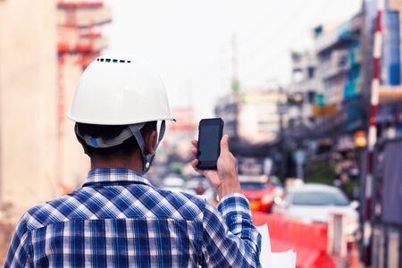 Foreman for construction control, use phone to communicate with staff
