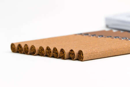 terminated: Cigarettes on the table on a white background