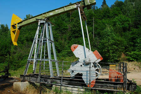The working oil pump in a mountain green areas