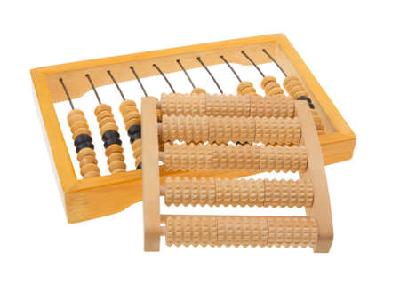 a wooden massager and wooden abacus on white background photo