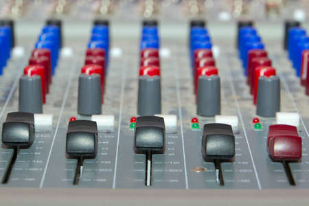 engineer's: Buttons equipment in the recording studio close-up
