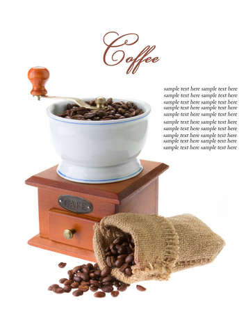Wooden grinder with coffee beans isolated on white background photo