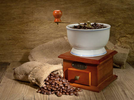 flavorful: Wooden grinder with coffee beans on the tree with a bag