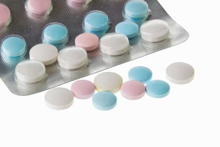 vitamin tablets pills of different colors on a white box photo