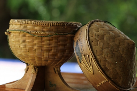 Sticky rice box,be the light while,member northeast in which,the aborigine in northeastern area of Thailand adds sticky rice steams cooked for already induce to eat,which, be the utensils that do to go up build the bamboo by the basket making,regard a photo