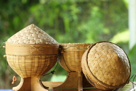Sticky rice box,be the light while,member northeast in which,the aborigine in northeastern area of Thailand adds sticky rice steams cooked for already induce to eat,which, be the utensils that do to go up build the bamboo by the basket making,regard a Stock Photo - 13915379