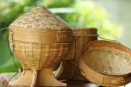 northeastern: Sticky rice box,be the light while,member northeast in which,the aborigine in northeastern area of Thailand adds sticky rice steams cooked for already induce to eat,which, be the utensils that do to go up build the bamboo by the basket making,regard a