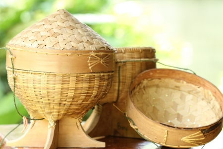 Sticky rice box,be the light while,member northeast in which,the aborigine in northeastern area of Thailand adds sticky rice steams cooked for already induce to eat,which, be the utensils that do to go up build the bamboo by the basket making,regard a Stock Photo - 13915374