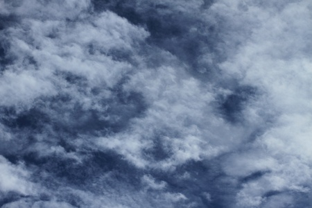 drifting: clouds in the sky drifting away in a light breeze