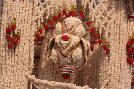 Garlands made of popped Marchers to worship the faith of the Prophet by Buddhists in Thailand, Yasothon. Stock Photo