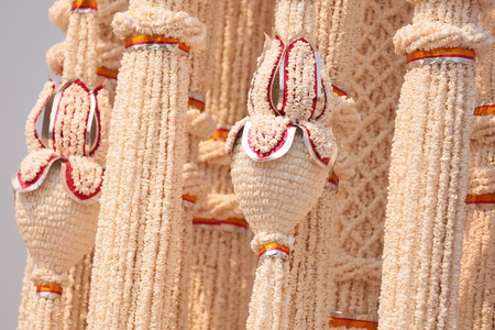 sacrifices: Garlands made of popped Marchers to worship the faith of the Prophet by Buddhists in Thailand, Yasothon. Stock Photo