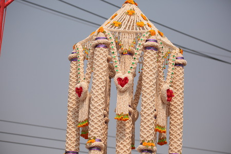 marchers: Garlands made of popped Marchers to worship the faith of the Prophet by Buddhists in Thailand, Yasothon. Stock Photo