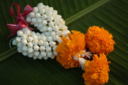 Thai Flowers Garland on leaf background Stock Photo