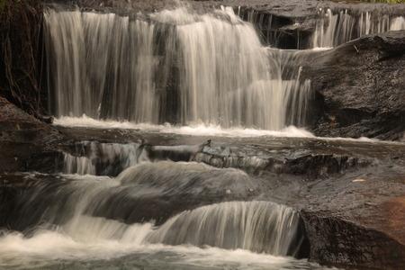 khong river: Sang Chan or Moon light Waterfall (Nam tok long roo),: Water flows through a rock waterfall. Ubon ratchathani, Thailand  in rain Stock Photo
