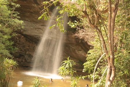 roo: Sang Chan or Moon light Waterfall (Nam tok long roo),: Water flows through a rock waterfall. Ubon ratchathani, Thailand  in rain Editorial