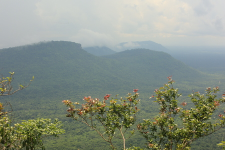 Nature backgrounds /Dramatic clouds with mountain and tree: Pha Mo e- Daeng sisaket Thailand.