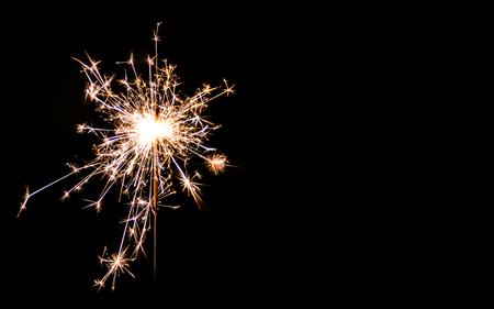 sparklet: Christmas sparkler on black background. Bengal fire Stock Photo