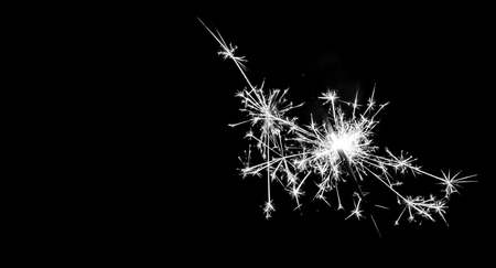 black color: Christmas sparkler on black background. Bengal fire Stock Photo
