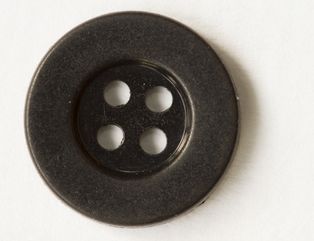 sewing buttons: Sewing buttons