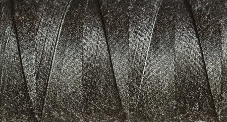 lurex: Spool of thread macro background Stock Photo