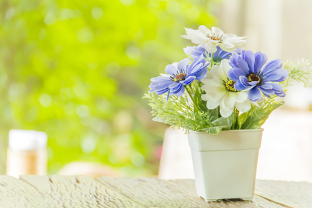 home life: Fake flowers on wood