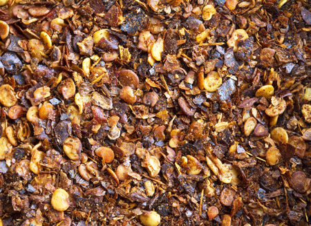crushed red peppers: Detailed background pepper Stock Photo