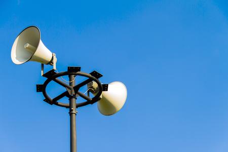 warning system: loudspeaker warning system. system of alert for population: sound amplifier with loudspeaker against the sky