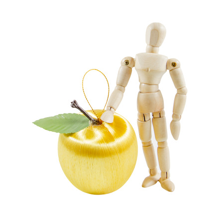 Wooden puppet with yellow apples. Isolated on white background