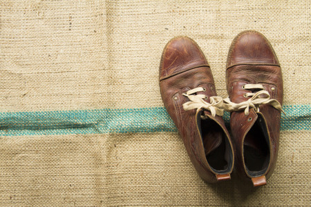 Brown leather shoes on the sacks.