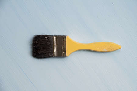 modernise: Paint brushes on a wooden blue background.