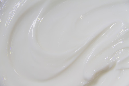 The white surface of the cream lotion softens the background. Archivio Fotografico - 119057517