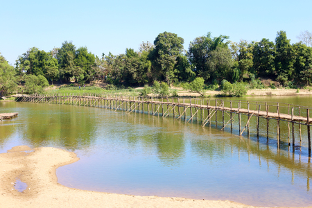 Bamboo bridge across the river in Myanmar. Archivio Fotografico - 119057821