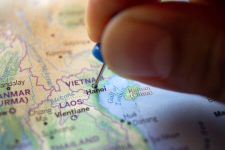 Hand pin on the map of Hanoi, Vietnam