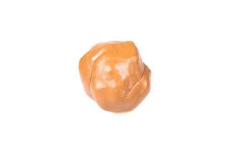 Brown plasticine isolated on white background. Stock Photo